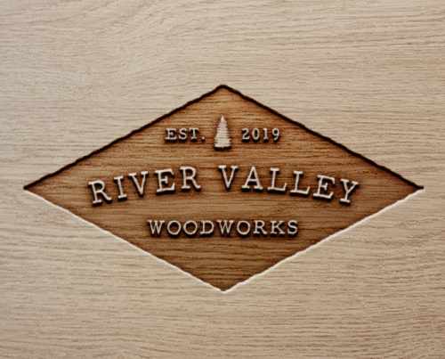 River Valley Woodworks logo mocked up on wood